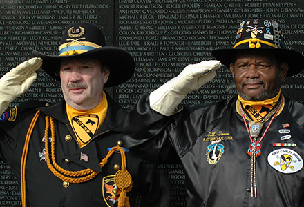 Two men saluting