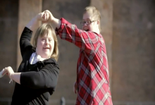 Man and woman with down syndrome dancing