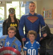 Isaac with super heroes